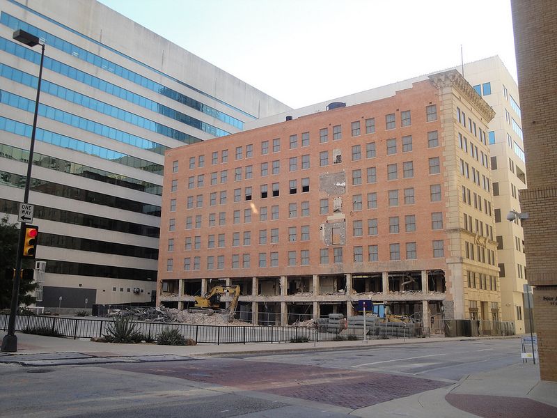After several years of vacancy, the Thomas building was imploded to make room for an expanded parking lot